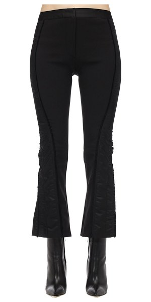 Mugler Flared techno grain de poudre pants in black