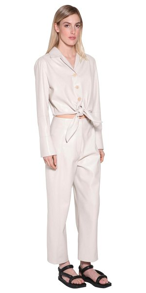 Nanushka Ana faux leather jumpsuit w/ cut out in cream