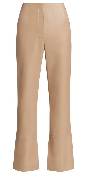 Nanushka rhyan vegan leather pants in sandstone