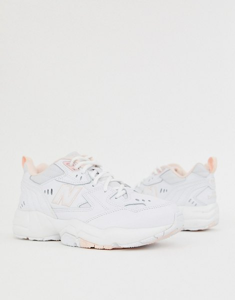 New Balance 608 trainers in white and pink in pink
