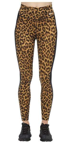 Nike Leopard print mid rise tight leggings in gold