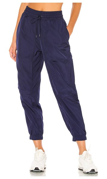 Nike nsw tech pack woven pant in blackened blue