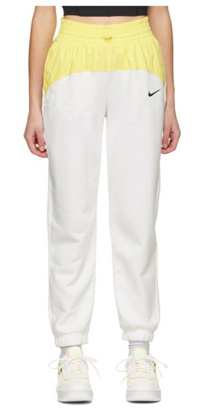 Nike white and yellow sportswear icon clash lounge pants in 100 white,l