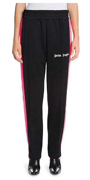 Palm Angels logo track pants in black pink - Bold contrast stripes and sporty styling add a classic...