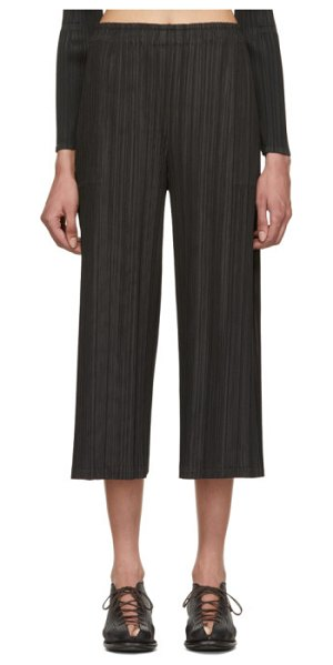 Pleats Please Issey Miyake March Pleated Trousers in black - Wide-leg garment-pleated trousers in black. Elasticized...