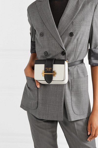 Prada cahier smooth and textured-leather belt bag in white - Prada's 'Cahier' bag is named after - and inspired by -...