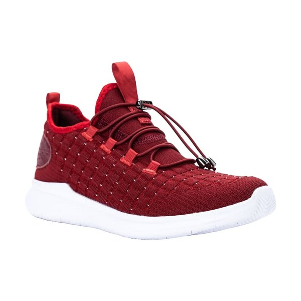 Propet travelbound stretch sneaker in red metallic fabric