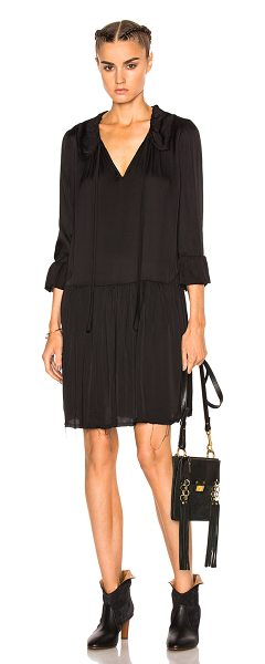Raquel Allegra Ruffle Neck Dress in black - Raquel Allegra gained instant popularity for her...