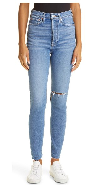 RE/DONE '90s ultra high waist skinny jeans in broken through with rips