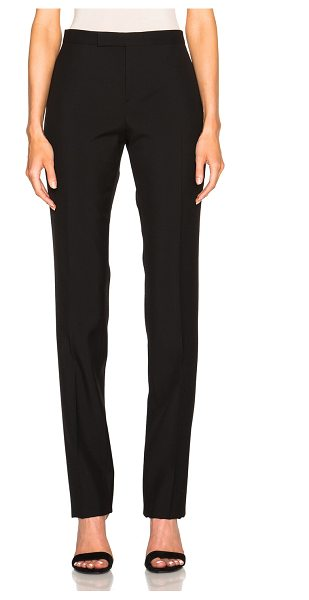Saint Laurent Low Waist Gabardine Trousers in black - Self: 100% virgin wool - Lining: 100% cotton.  Made in...