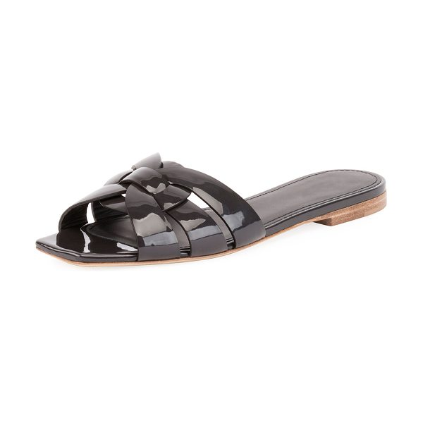 Saint Laurent Tribute Patent Leather Flat Slide Sandal in fog - Saint Laurent sandal in patent leather. Flat stacked...