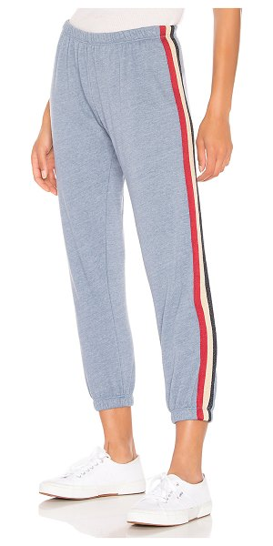 Spiritual Gangster Stripe Perfect Sweatpant in blue - 50% poly 37% cotton 13% rayon. Elasticized waist....