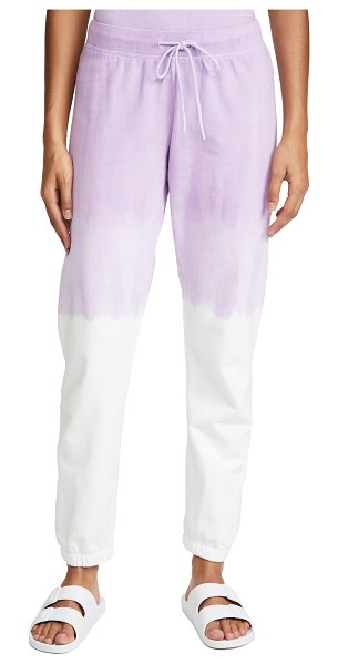 Splits59 charlie sweatpants in off white/lavender dip dye