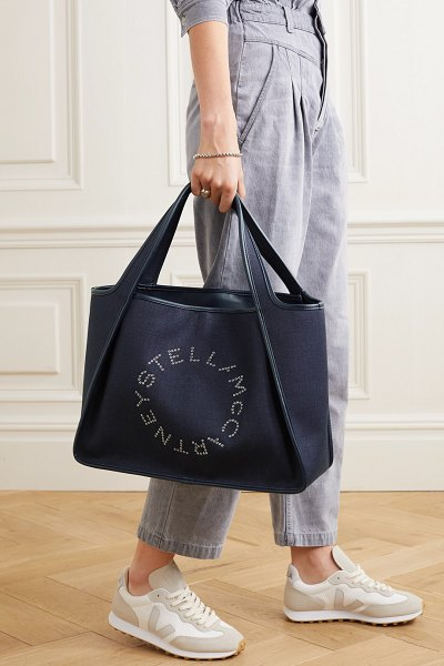 Stella McCartney eyelet-embellished faux leather-trimmed linen-canvas tote in navy