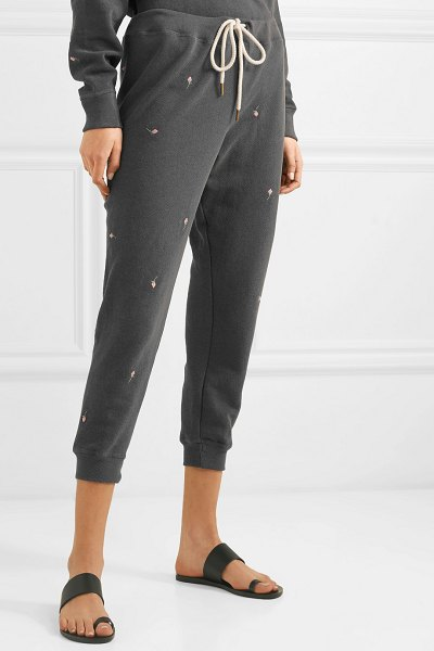 The Great the cropped embroidered cotton-jersey sweatpants in black