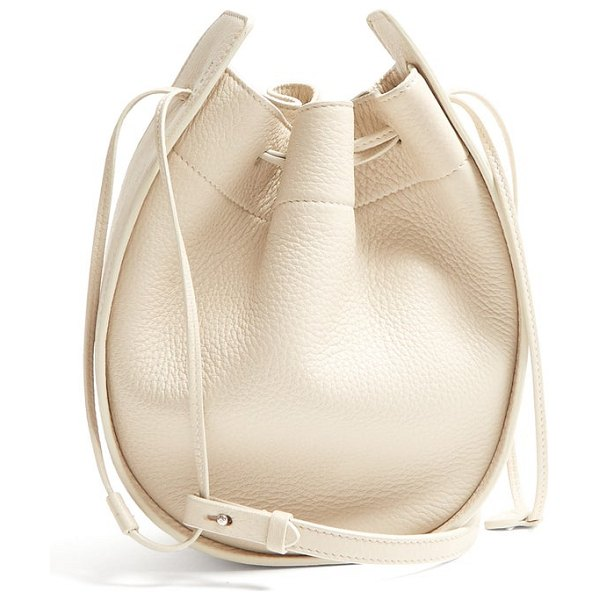 THE ROW drawstring leather cross body bag in cream