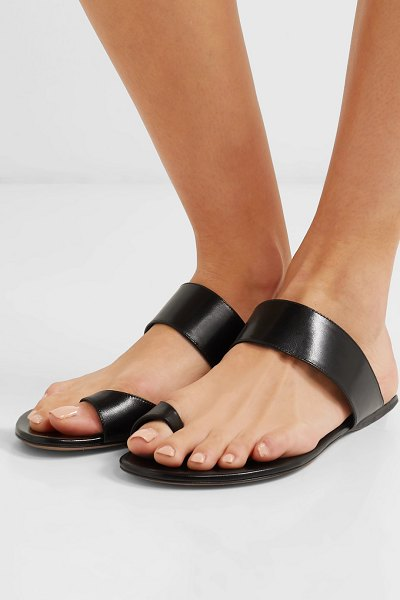 THE ROW infradito leather sandals in black - The Row's Mary-Kate and Ashley Olsen appreciate the...