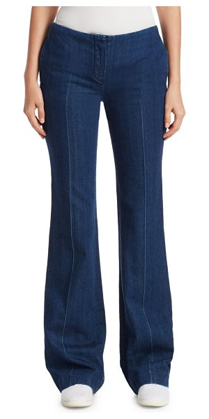 THE ROW keith jeans in indigo - Low-rise denim in a flared silhouette. Zip fly. Side...