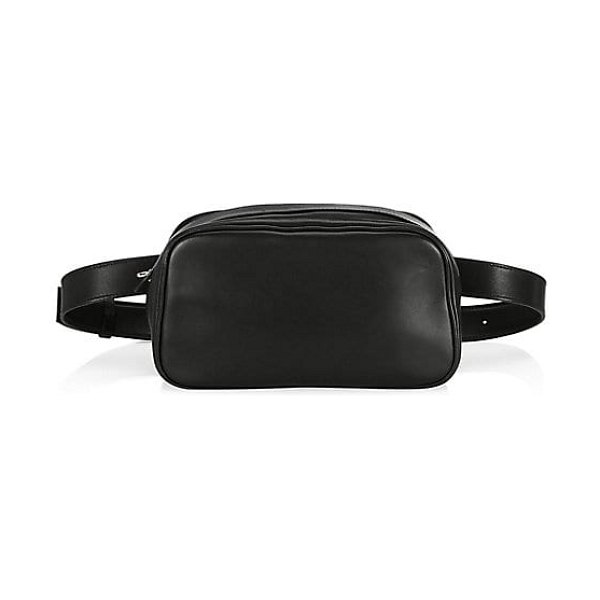 THE ROW belt bag in black - On-trend belt bag finished with luxe leather trim....