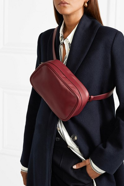 THE ROW leather belt bag in burgundy