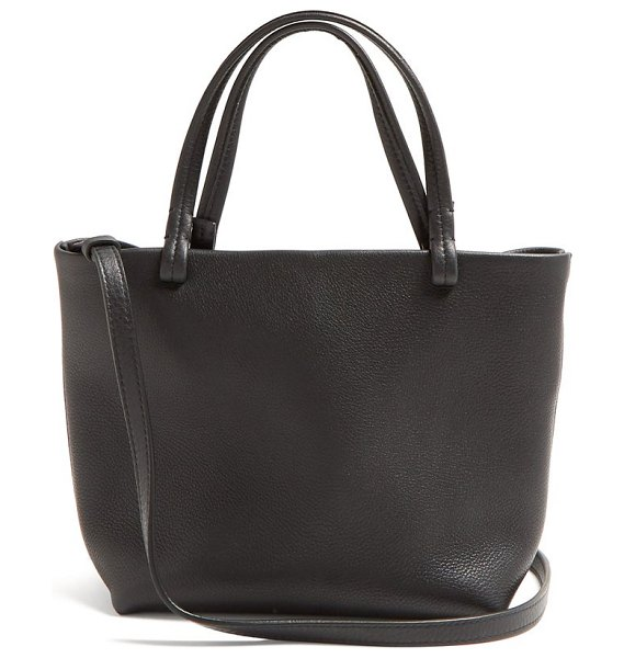 THE ROW park grained leather cross body bag in black - The Row - The Row's stripped-back approach to design is...