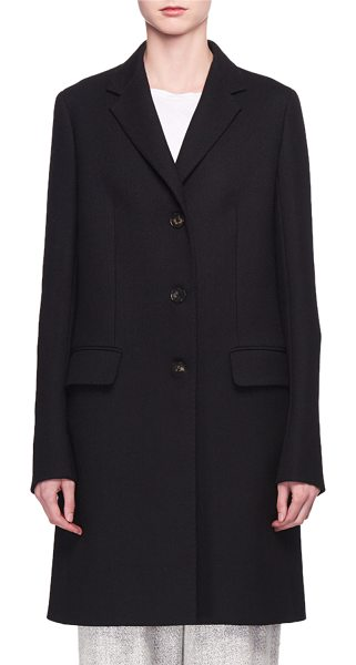 THE ROW Three-Button Long Wool Coat in black - The Row coat in virgin wool. Notched lapels. 3 button...