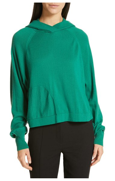Tibi crop hoodie in green - A dash of merino wool makes this cropped raglan hoodie...