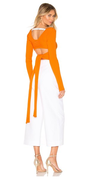 Tibi Ribbed Wrap Sweater in orange - 100% poly. Dry clean only. Ribbed knit fabric....