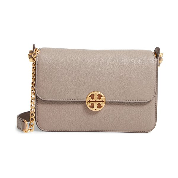 Tory Burch chelsea leather crossbody bag in gray heron - Pebbled leather and a gleaming logo medallion make this...