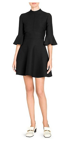 Valentino flutter-sleeve crepe couture dress in black - This chic highneck dress shapes the body with its...