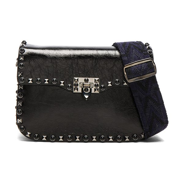 "Valentino Guitar Rockstud Rolling Noir Shoulder Bag in black - ""Wrinkled polished leather with suede lining and..."