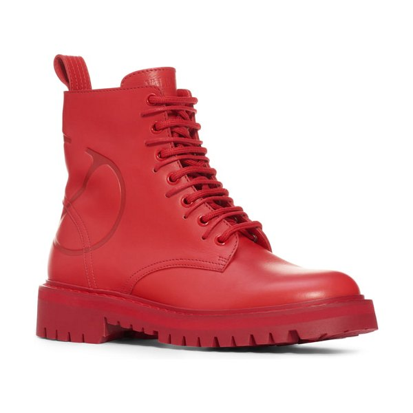 Valentino logo embossed combat boot in red leather