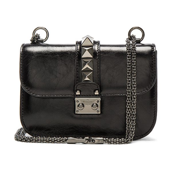 "Valentino Noir Small Lock Shoulder Bag in black - ""Wrinkled polished leather with raw lining and..."