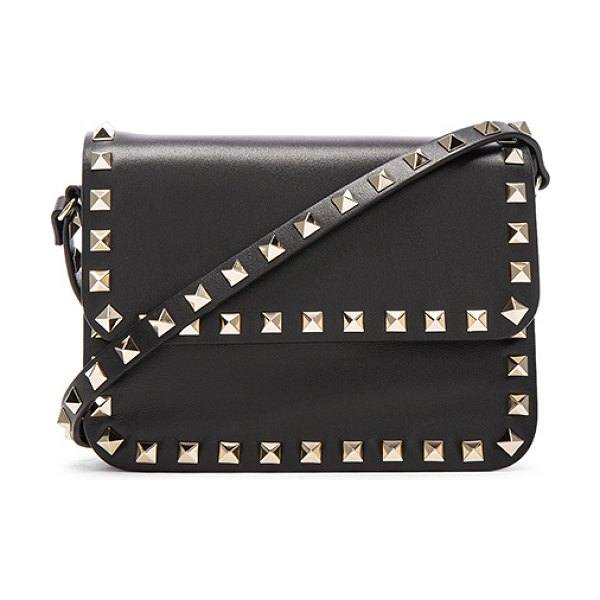 "Valentino Rockstud Shoulder Bag in black - ""Genuine leather with canvas lining and gold-tone..."