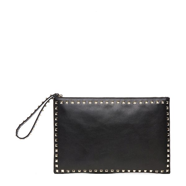 "Valentino Small Rockstud Clutch in black - ""Calfskin leather with canvas lining and gold-tone..."
