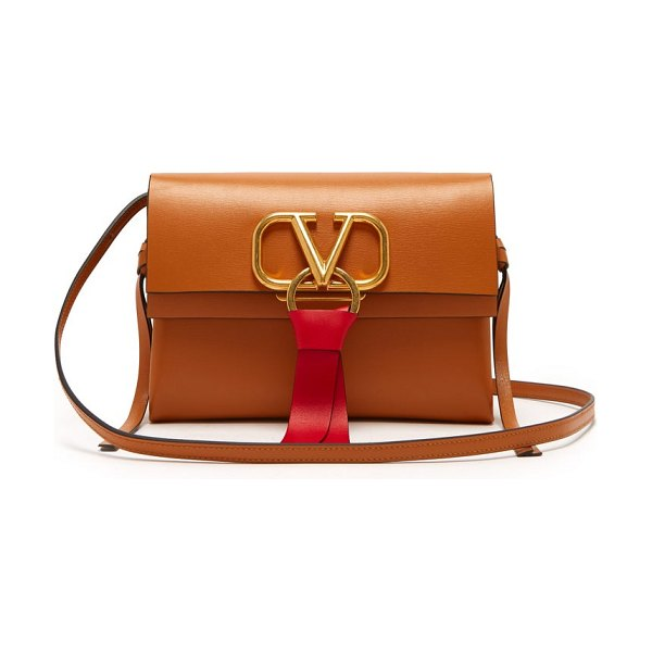 Valentino v ring small leather cross body bag in tan - Valentino - Valentino presents this sophisticated...