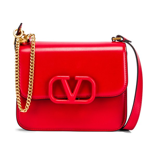 Valentino small vsling shoulder bag in rouge pur