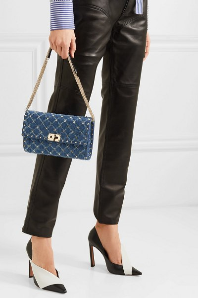 Valentino valentino garavani the rockstud spike quilted distressed denim shoulder bag in mid denim - If you're a fan of Valentino Garavani's signature...