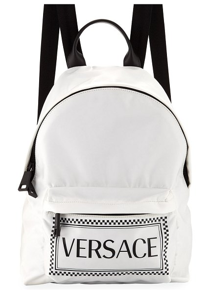 VERSACE Logo Nylon Backpack in white/black - Versace nylon backpack with logo-print front. Rolled...
