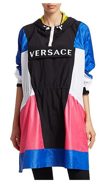 VERSACE long-sleeve logo colorblock poncho in blue - This retro-inspired poncho flaunts an eclectic...
