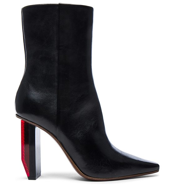 VETEMENTS Reflector Leather Ankle Boots in black - Leather upper and sole.  Made in Italy.  Shaft measures...