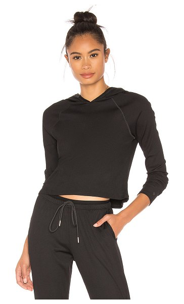 Wear It To Heart Lucky Hooded Long Sleeve Top in black - 92% nylon 8% spandex. Attached hood. Ribbed fabric....