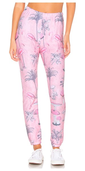 Wildfox Pink Paradise Knox Sweatpant in pink - Poly blend. Elasticized waist and leg openings. Fleece...
