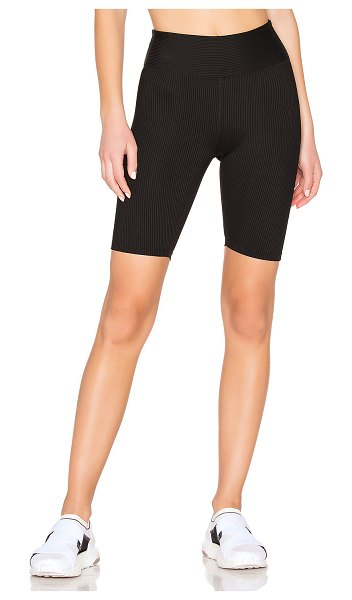YEAR OF OURS Ribbed Biker Short in black - Nylon blend. Stretch fit. Ribbed fabric. Made in USA....