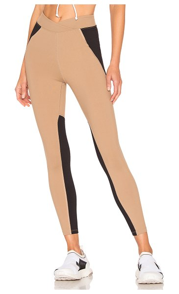YEAR OF OURS x REVOLVE Motorsport Legging in brown - 80% nylon 20% spandex. Criss-cross waistband. Contrast...