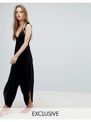 Akasa Fluted Leg Beach Jumpsuit With Pom Pom Ties