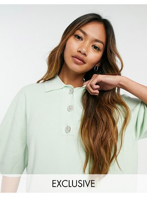 Annorlunda knitted polo with large button detail-green