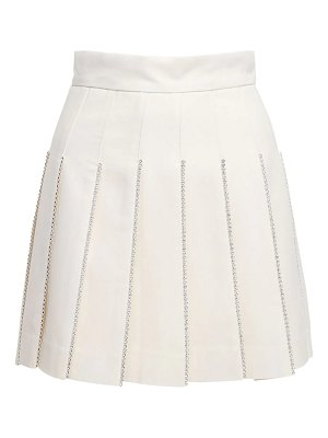 AREA Pleated mini skirt w/crystals