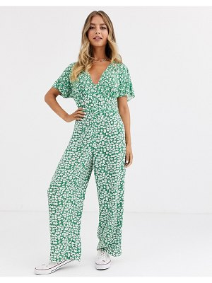 ASOS DESIGN button front jumpsuit in mixed green floral print