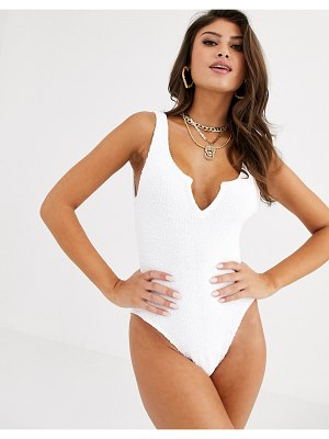 ASOS DESIGN crinkle notch front swimsuit in white